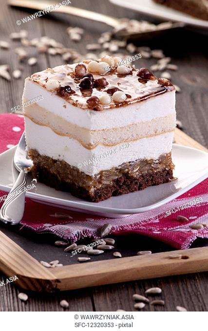 Layered cake with chocolate balls and sunflower seeds