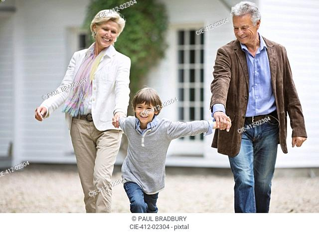 Couple walking with grandson outdoors