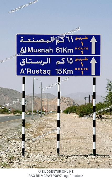 Sultanate Oman, street child with Rustaq, street sign near Rustaq