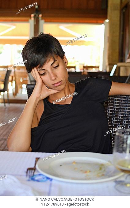 Bored young woman at restaurant