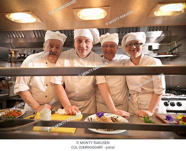 Chefs smiling in kitchen