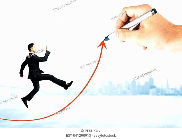 Businessman running up abstract arrow drawn by hand on city background. Success and money concept