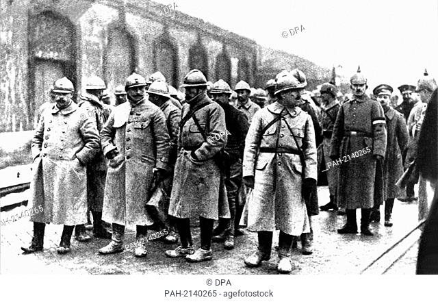 French officers, who are prisoners of war, wait for their transport. Roughly 700,000 people died in the Battle of Verdun (February to December 1916)