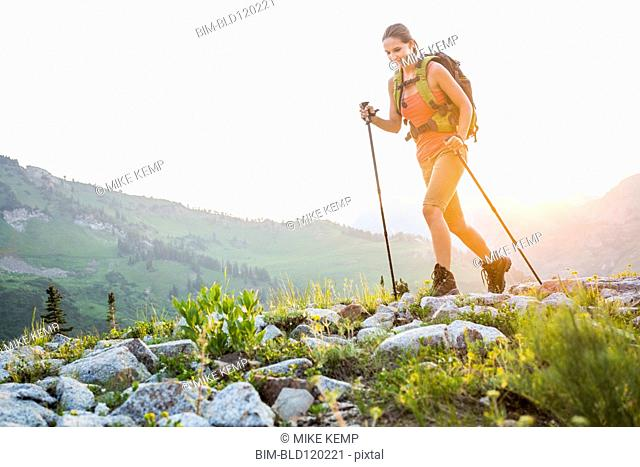 Caucasian woman hiking on rocky trail