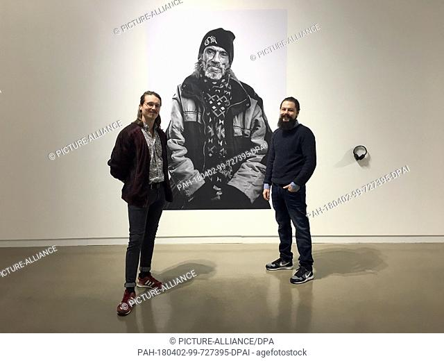 15 February 2018, Germany, Mannheim: Mirko Mueller (L)and Jonas Gieske stand in the gallery 'port25' during the presentation of the photography project 'Ueber...