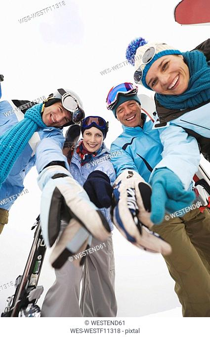 Italy, South Tyrol, Young people in winter clothes, low angle view