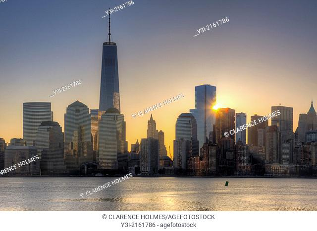 The sun rises next to 4 World Trade Center as the Freedom Tower 1 WTC stands tall nearby in the World Trade Center complex, in New York City, New York, USA