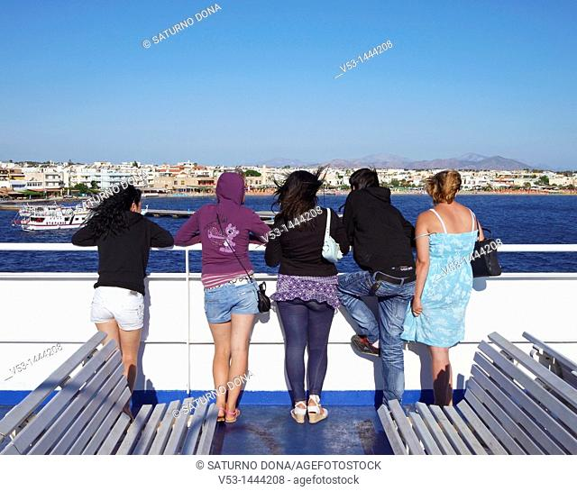 group of young women looking at Kos Town from the Ferry Boat - Greece