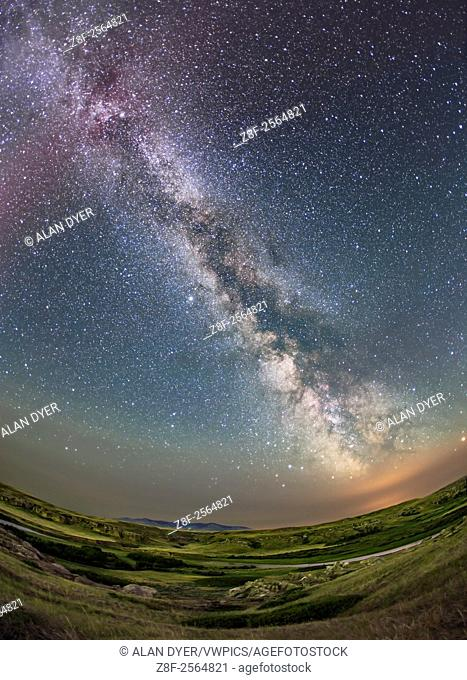 The summer Milky Way over the Milk River Valley and sandstone formations of Writing-on-Stone Provincial park, in southern Alberta