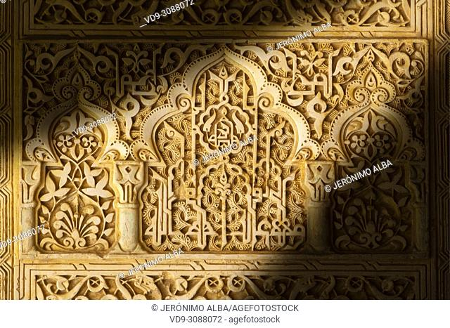 Decorative carving in wall plaster work in the Nasrid Palace. Alhambra, UNESCO World Heritage Site. Granada City. Andalusia, Southern Spain Europe