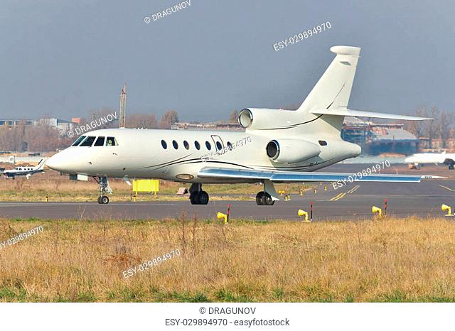 Private business jet plane on runway at the airport