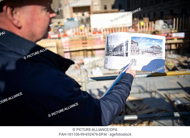 25 October 2018, Berlin: Frank Röger, overall project manager of the construction site at the Pergamonmuseum, shows a brochure depicting the old and newly...