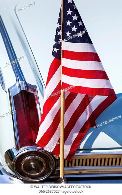 USA, Massachusetts, Cape Ann, Gloucester, antique car show, 1960s . Plymouth Valiant with US flag