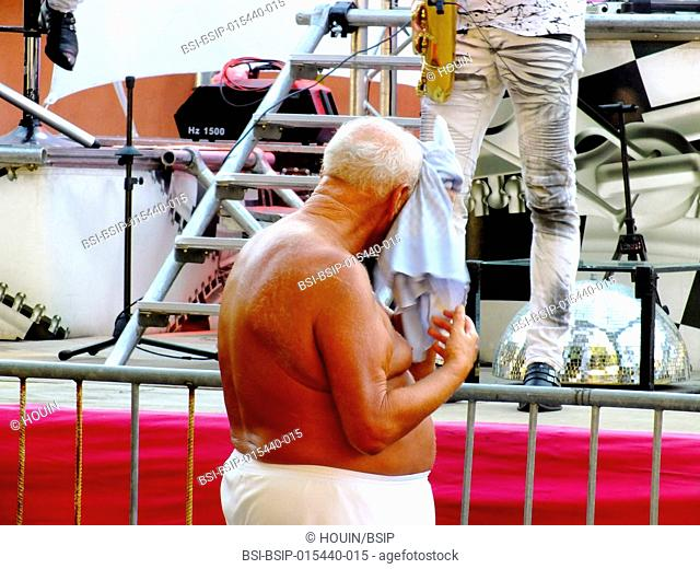 Man suffering from heat