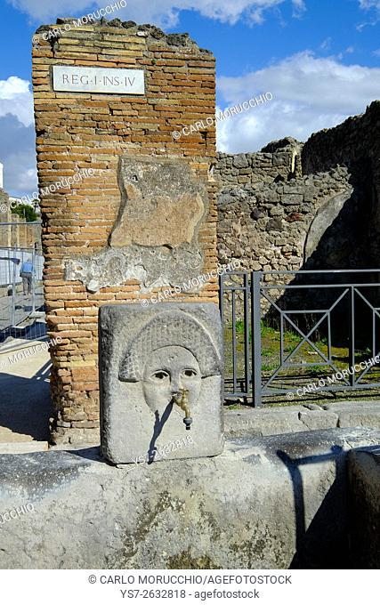 Drinking fountain at Via dell'Abbondanza, Pompeii the ancient Roman town near Naples, Campania, Italy, Europe