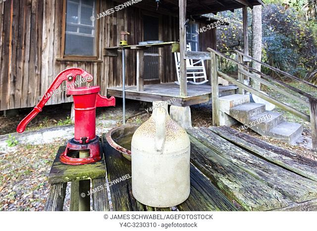 Eater pump and jug outside the Pioneer cabin at the Crowley Museum & Nature Center in Sarasota Florida