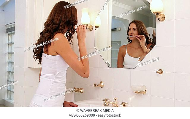 Pretty woman checking herself in the morning
