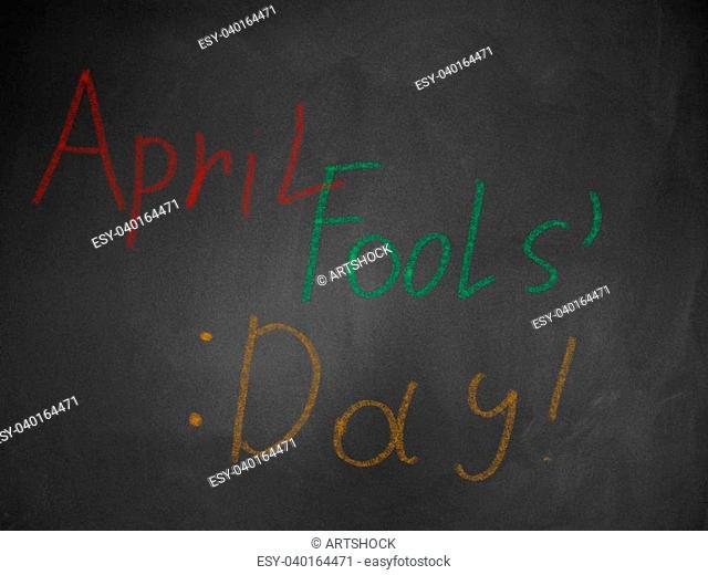 April fools' day written in colorful chalk on blackboard