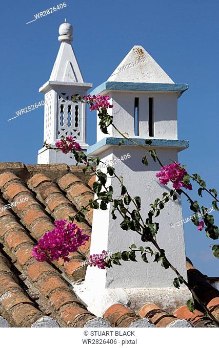 Filigreed chimney pots and Bougainvillea, Algarve, Portugal, Europe