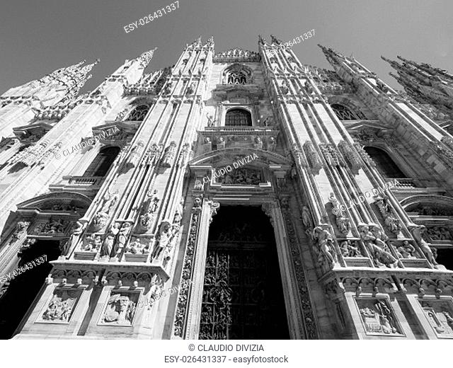 Duomo di Milano gothic cathedral church in Milan, Italy in black and white