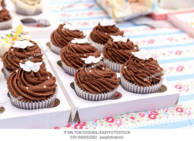 Homemade chocolate cupcakes on a market stall
