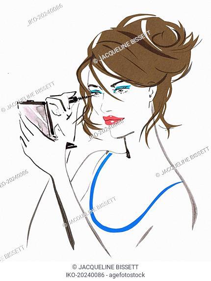 Close up beautiful woman applying mascara