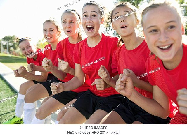 Young soccer girls cheering from the sidelines