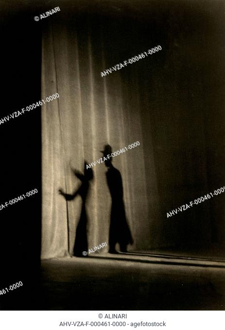 Grand Variety. Shadows of two actors projected on the curtains of a theater, shot 1946 by Vannucci Zauli, Giuseppe