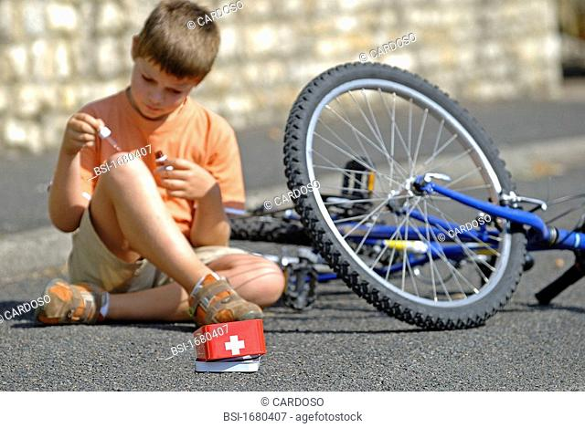 WOUND CARE, CHILD Model. Disinfection of a wound after falling off the bike