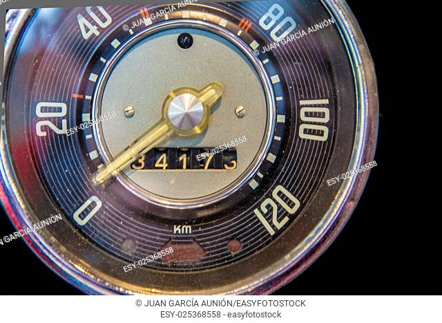 Old car speedometer. Isolated over black background