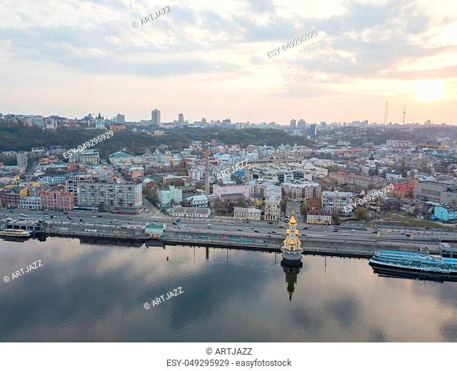 Kiev, Ukraine: 15 April, 2018 - Church of St. Nicholas the Wonderworker on Dnieper River on sunset, photography from drone City landscape with evening sky and...