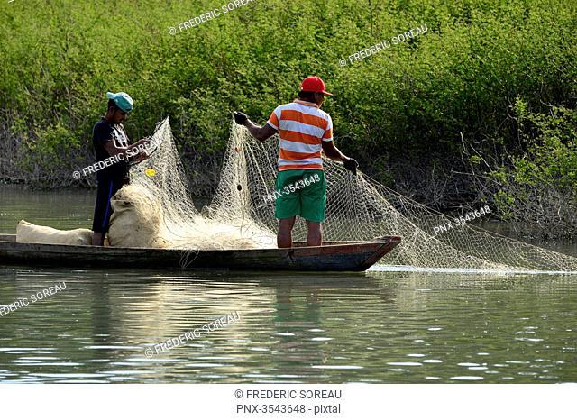 Fishermen holding a fishing net in Rio Dulce, Guatemala, Central America