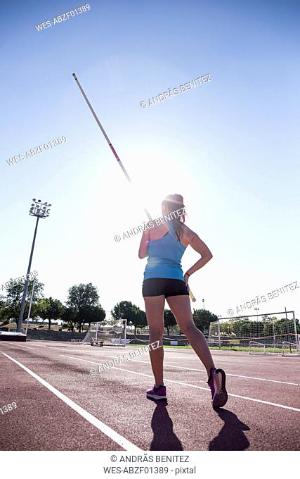 Female pole vaulter preparing
