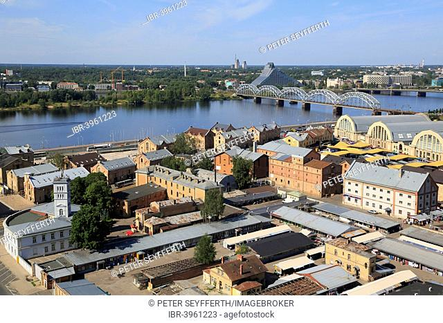 Daugava River with the Railway Bridge or Dzelzcela Tilts and the New National Library, market halls and the Spikeri warehouse complex