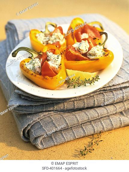 Baked, stuffed yellow peppers with herb quark filling