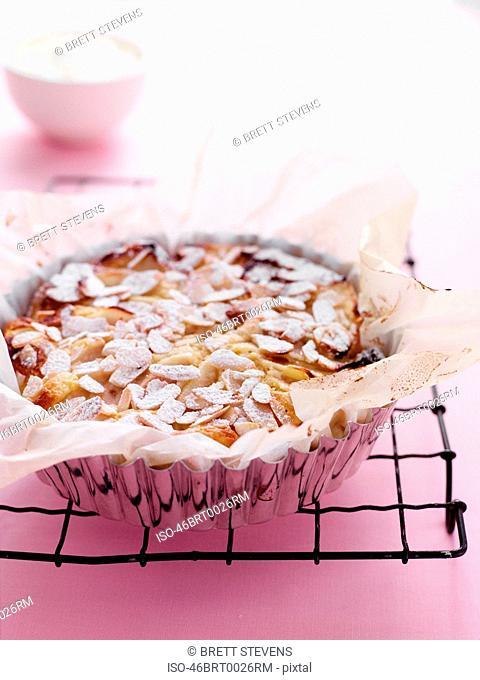 Dish of pear almond tart on rack