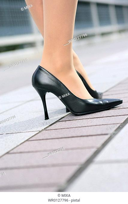 Close-up of a young womans feet in heels