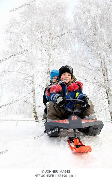 Two boys sledging