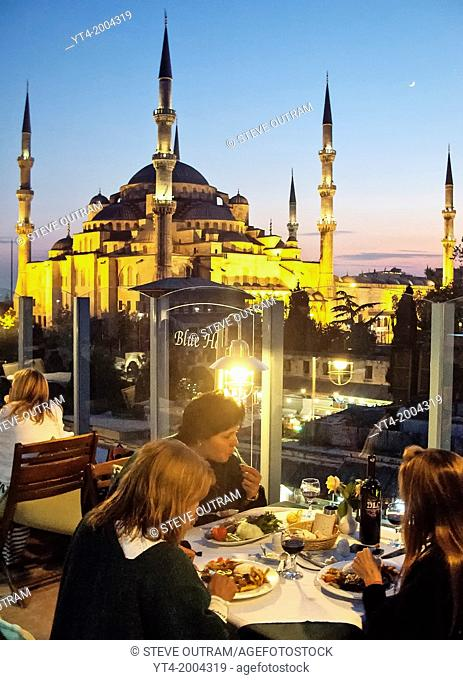 People dining at The Blue House Hotel Restaurant, Sultanahmet, Istanbul, Turkey
