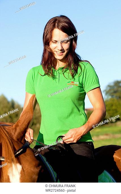 Women on Horseback Riding in a Landscape