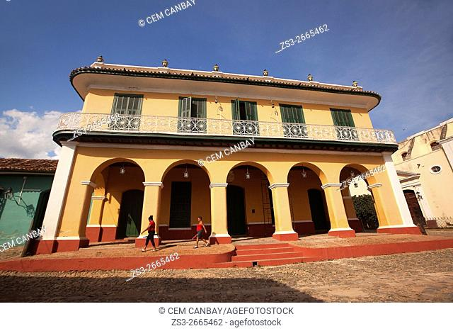 Women in front of the Romantic Museum in town center, Plaza Mayor, Trinidad, Sancti Spiritu Province, Cuba, West Indies, Central America