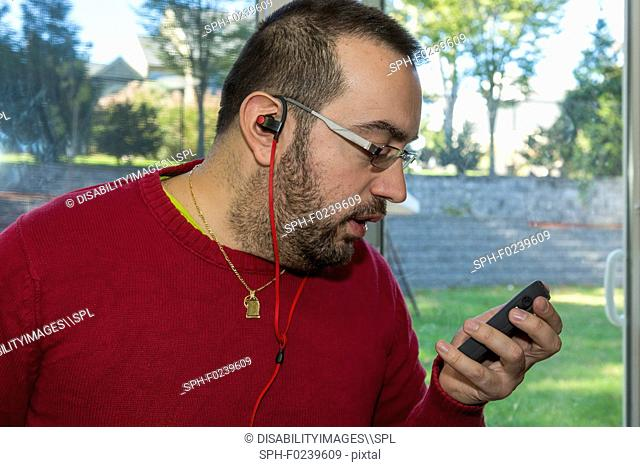 Man with visual impairment listening to his phone