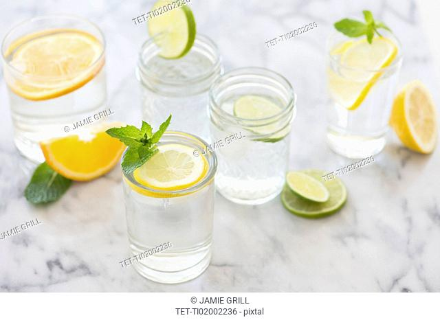 Studio shot of drinks with lemon, lime and orange