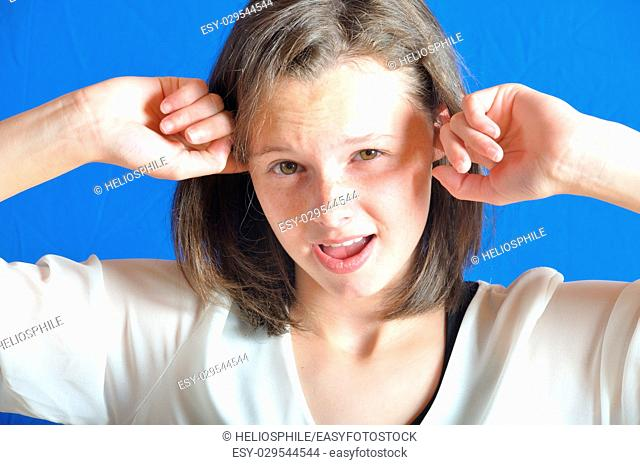 Teenage girl with her fingers in her ears