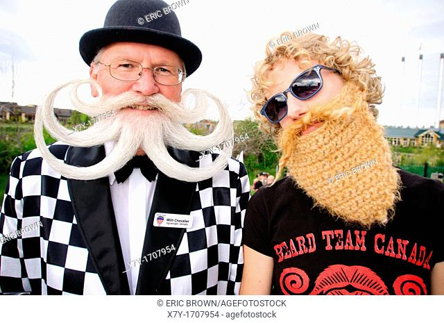 Willi Chevalier a competitor at the 2010 USA National Beard and Moustache Championships with a young woman in a fake beard, in Bend, OR, USA  June 5, 2010