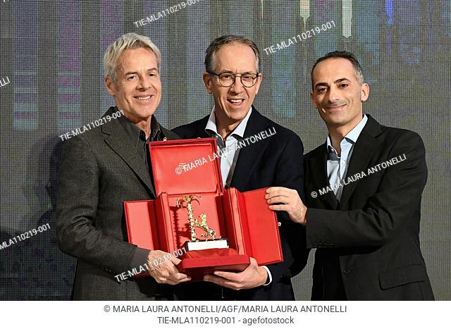 Claudio Baglioni receives the 'Amico di Sanremo ' Award (Friends of Sanremo) from the Mayor of Sanremo Alberto Biancheri (center) during the final press...