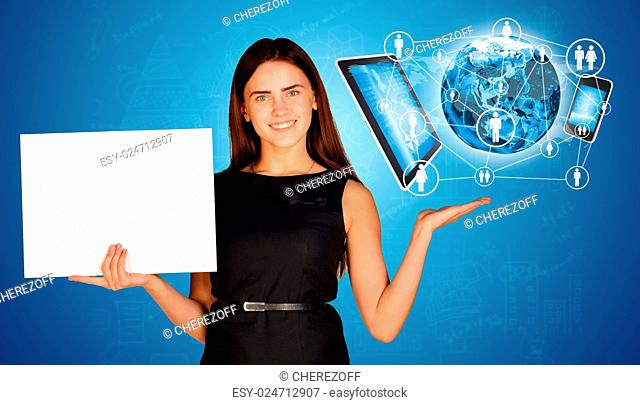 Businesswoman holding empty paper sheet and Earth with electronics. Elements of this image are furnished by NASA