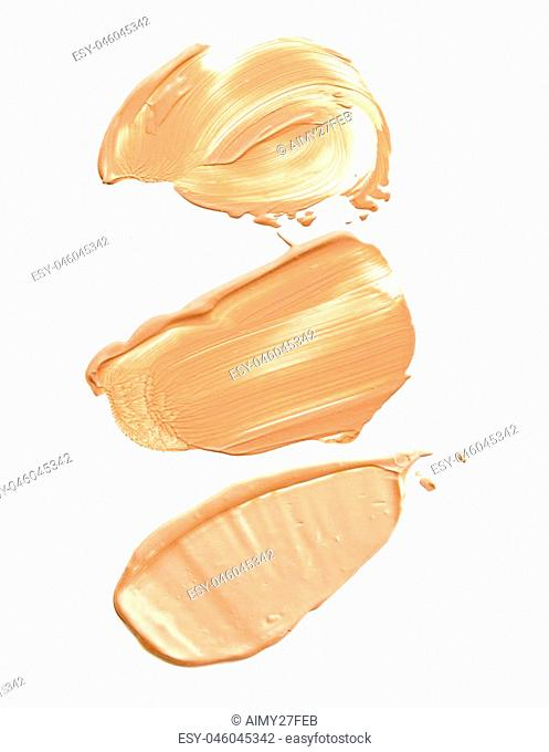 collection of various make up liquid powder strokes on white background