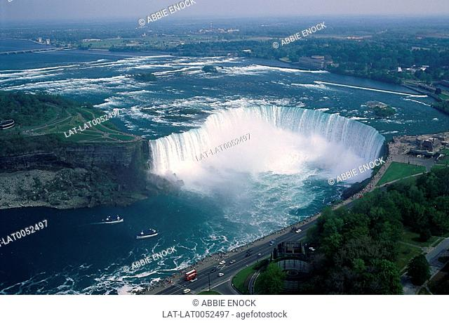 Aerial view. Niagara River. Horseshoe Falls. Two Maid-of-the-Mist boats. Spray