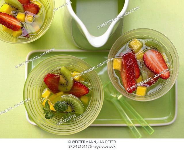 A fruit punch with apple juice, mint cordial and mineral water